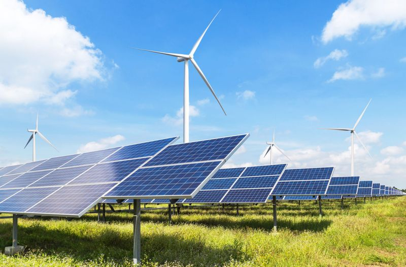 solar panels and wind turbine for renewable electricity